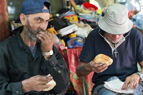 Homeless people eating